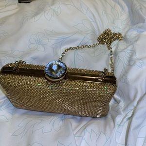 Gold rhinestone clutch